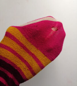 Old sock with hole